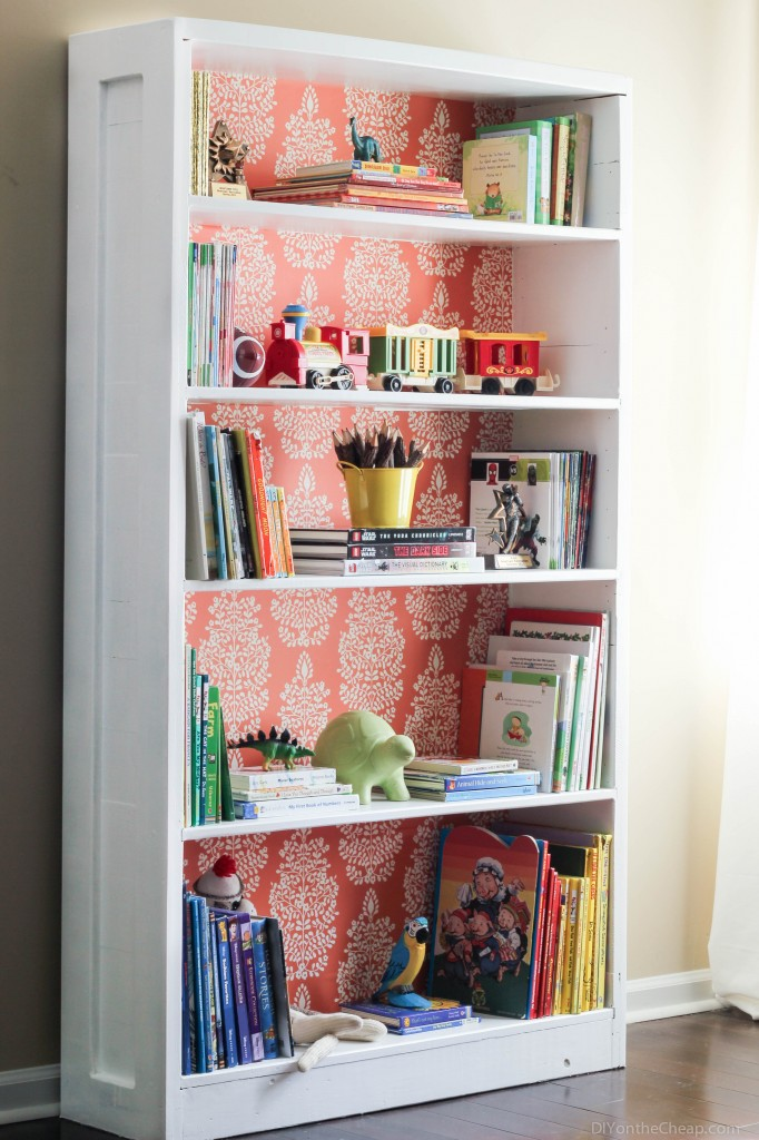 Give an inexpensive bookcase a high-end look with wallpaper