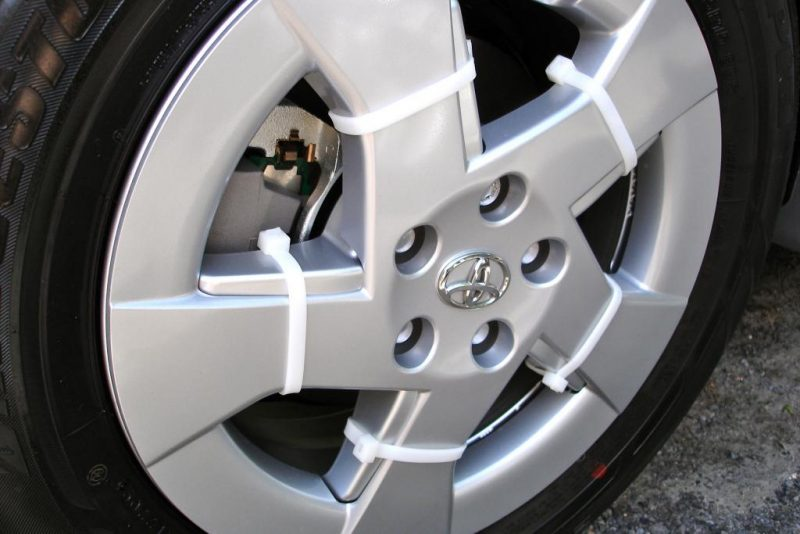 Never lose a hubcap again by securing them with zip ties