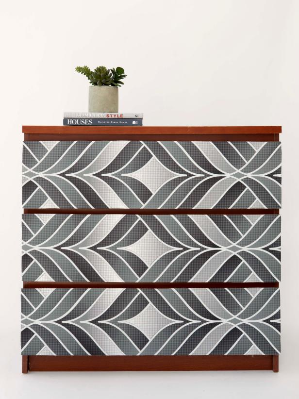 Use wallpaper to line the front of the drawers