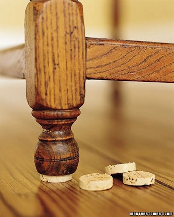 Turn wine corks into furniture floor protectors