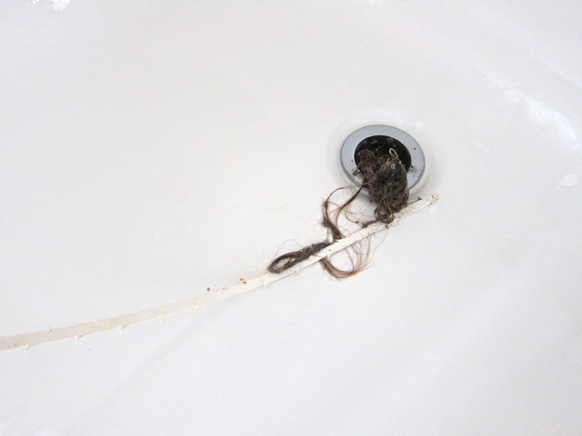 Unclog a drain with a zip tie