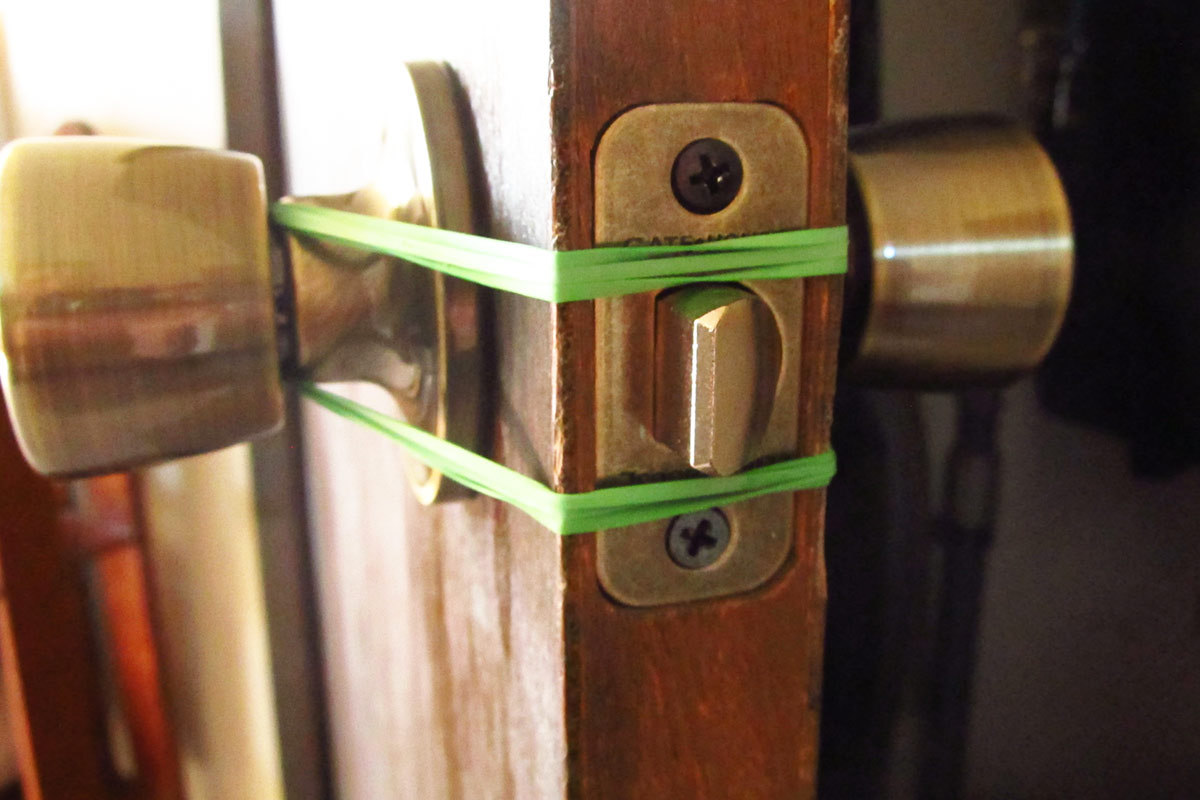 Add a Rubber Band to Door Knobs to Soften Slamming Doors