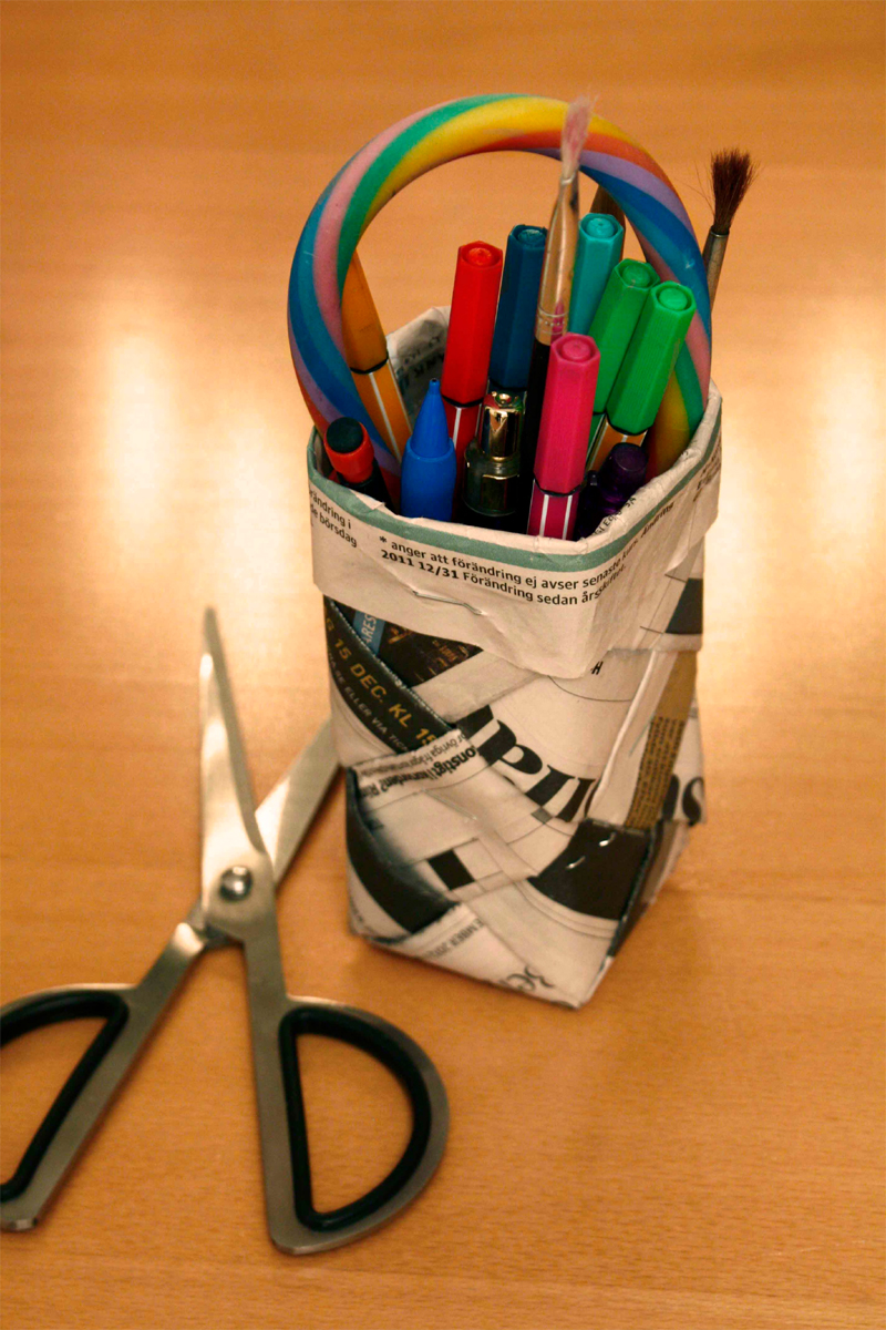Newspaper pencil holder