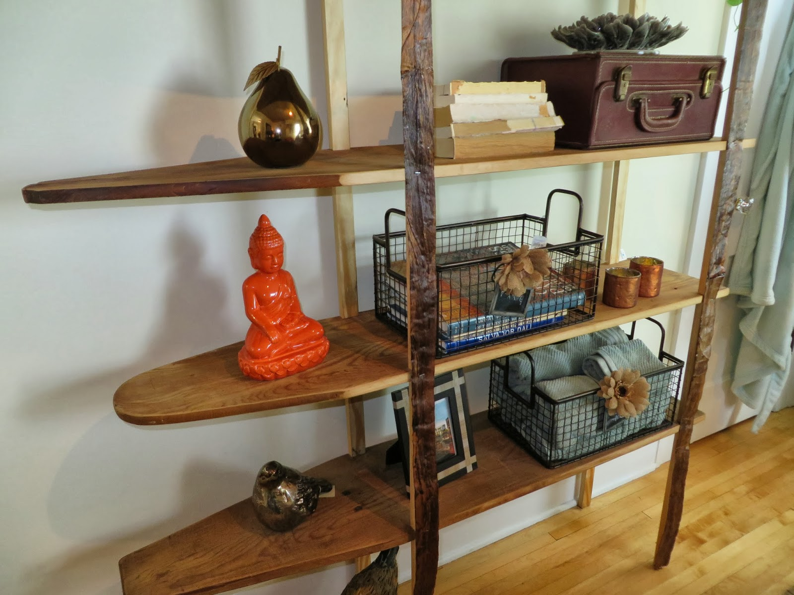 Wooden Ironing Boards Utilized as a Shelving Unit