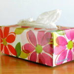 Turn a tissue box into a plastic bag holder