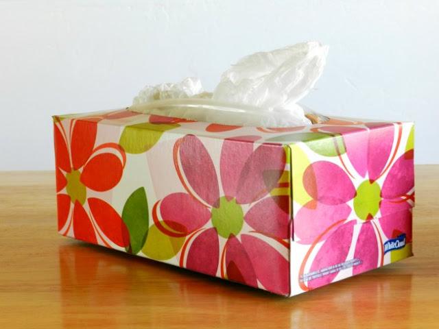 Turn a tissue box into a plastic bag holder