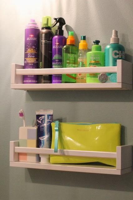 Turn spice racks into bathroom storage
